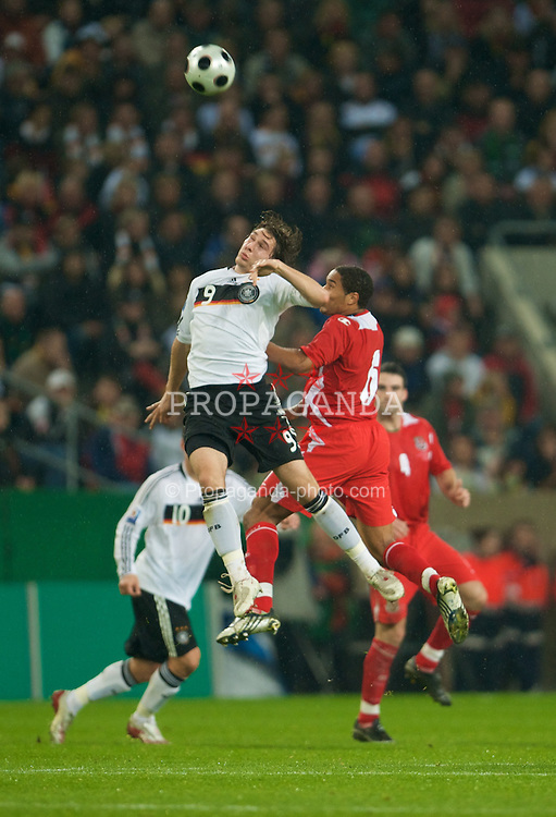 MONCHENGLADBACH, GERMANY - Wednesday, October 15, 2008: Wales' Ashley Williams and Germany's Patrick Helmes during the 2010 FIFA World Cup South Africa Qualifying Group 4 match at the Borussia-Park Stadium. (Photo by David Rawcliffe/Propaganda)