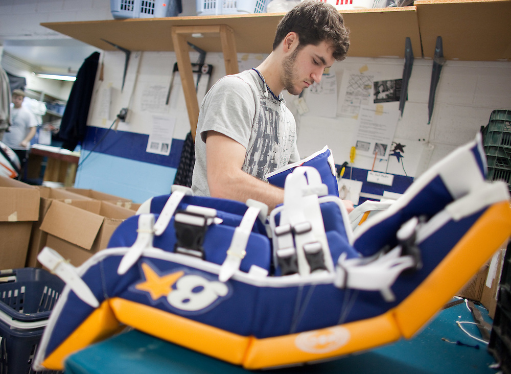 Kingsville, Ontario ---11-12-21---  Marc Tremblay assembles goalie pads at Brian's Custom Sports in Kingsville, Ontario, December 21, 2011. Winnipeg Jets goalie Chris Mason has ordered some custom pads from the company which have recently received final approval from the NHL.  Mason hopes to start wearing them in games soon.<br /> GEOFF ROBINS The Globe and Mail
