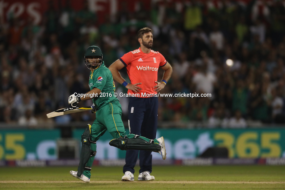 Pakistan's Khalid Latif running between wickets while Liam Plunkett looks on.<br /> England v Pakistan, only T20 at Manchester, England. 7 September 2016.<br /> Pakistan won by 9 wickets (with 31 balls remaining).<br /> Copyright photo: Graham Morris / www.photosport.nz