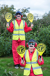 "© Licensed to London News Pictures;29/08/2020; Bristol Airport, Lulsgate Bottom, UK. ""The Landing Crew"" dressed as aircraft handlers take part in a Common Ground with Extinction Rebellion protest at Bristol Airport against plans to expand the airport and against the airport's decision to appeal against a refusal by North Somerset Council over the expansion plans. This is on the second day of a bank holiday weekend of protest across the UK by Extinction Rebellion. XR are protesting in Bristol and other cities in the UK against climate change, leading up to a protest in London starting on 01 September. XR say that despite clear scientific evidence of the deadly climate and ecological emergency, the UK government are refusing to take the urgent action needed to avoid mass extinction. XR say we need politicians to support the Climate and Ecological Emergency Bill. During the coronavirus covid-19 pandemic, climate change is being forgotten but it is still an emergency that is happening, the elephant in the room. Photo credit: Simon Chapman/LNP."