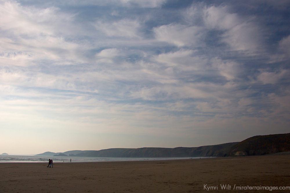 Europe, United Kingdom, Wales. Couple walking at Newgale Beach in Pembrokeshire.