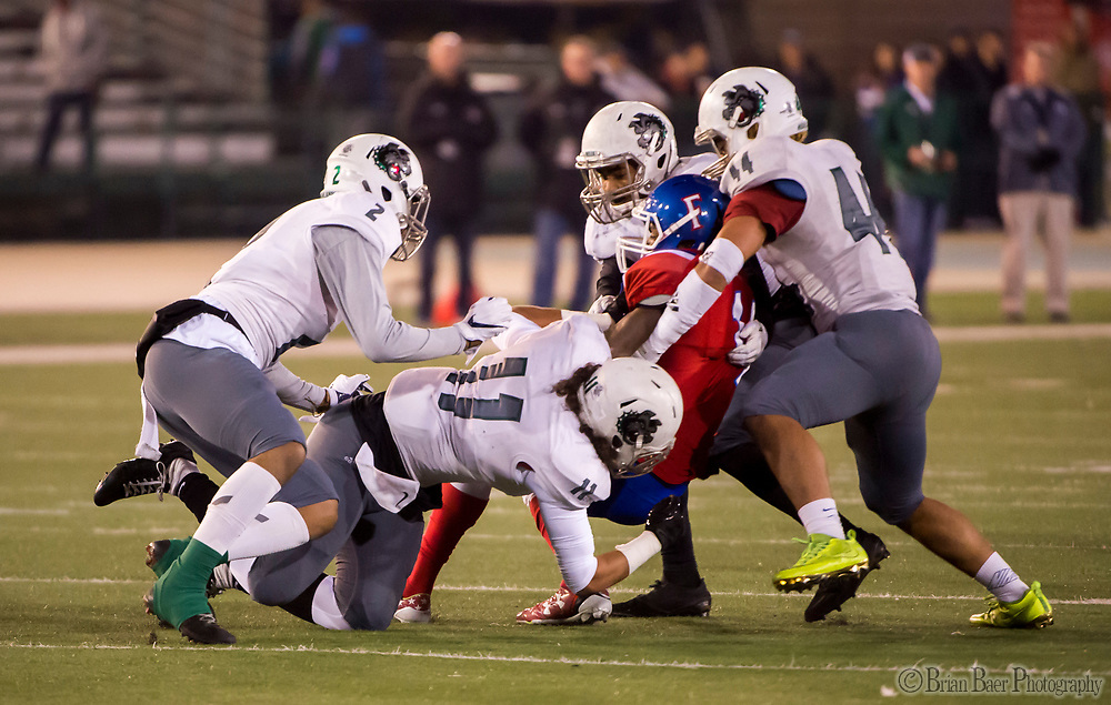 The Helix Highlander defense stops Folsom Bulldogs Elijhah Badger (14), during the first quarter as the Folsom Bulldogs play the Helix Highlanders in the CIF Division I-AA state title game, at Hornet Stadium at Sacramento State University, Friday Dec 15, 2017.