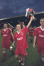 LIVERPOOL, ENGLAND - MAY 1996: Liverpool's Lee Prior (C) Mark Turkington (R) and Phil Brazier (L) celebrate winning the FA Youth Cup after beating West Ham United during the Final 2nd Leg at Anfield. (Pic by David Rawcliffe/Propaganda)