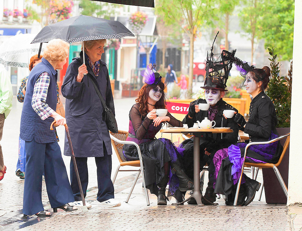 """25/07/2012. REPRO FREE. News. Spraoi Street Festival. Pictured at John Roberts Square, Waterford City  enjoying a coffee are  Amra Habibovic, Anthony O'Brien and Clair Walsh of """"The Darkness""""  who will take part in the Light of my Life parade during the Spraoi Festival Waterford City during the August Bank Holiday Weekend. Photo Patrick Browne"""