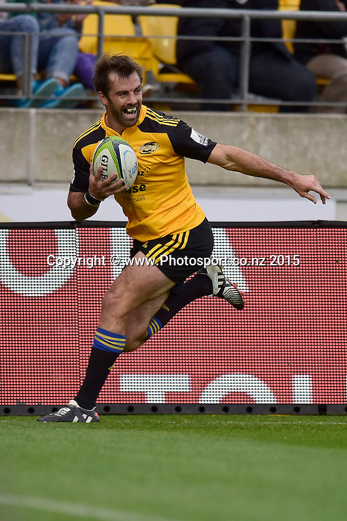 Hurricanes' captain Conrad Smith runs in a try during the Super Rugby - Hurricanes v Waratahs rugby union match at the Westpac Stadium in Wellington on Saturday the 18th of April 2015. Photo by Marty Melville / www.Photosport.co.nz