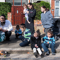 London, UK - 14 April 2014: On the morning before Passover, a family of the Jewish Community of Stamford Hill burn all the chametz (leavened products) during the bi'ur ceremony