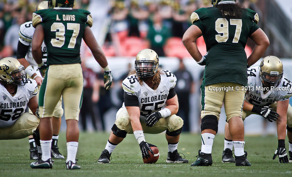 SHOT 9/1/13 6:39:45 PM - Colorado's Gus Handler #55 gets ready to snap the ball against Colorado State during the 2013 Rocky Mountain Showdown at Sports Authority Field at MiIe HIgh Stadium in Denver, Co. Colorado won the annual in-state rivalry 41-27. (Photo by Marc Piscotty / © 2013)