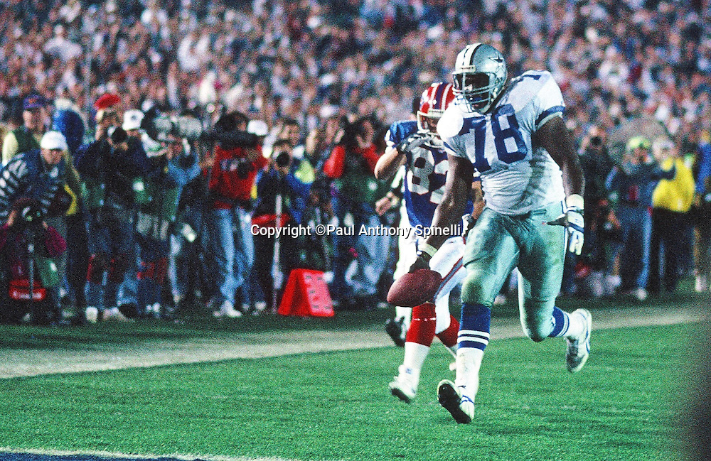Dallas Cowboys defensive tackle Leon Lett (78) showboats on a 64 yard fumble return for a near touchdown broken up at the one yard line by Buffalo Bills wide receiver Don Beebe (82) during the NFL Super Bowl XXVII football game against the Buffalo Bills on Jan. 31, 1993 in Pasadena, Calif. The Cowboys won the game 52-17. (©Paul Anthony Spinelli)