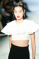Chiharu Okunugi walks the runway wearing Cushnie et Ochs Fall 2016, hair by Antonio Corral Calero for Moroccanoil, makeup by Val Garland, photographed by Thomas Concordia during New York Fashion Week on February 12, 2016