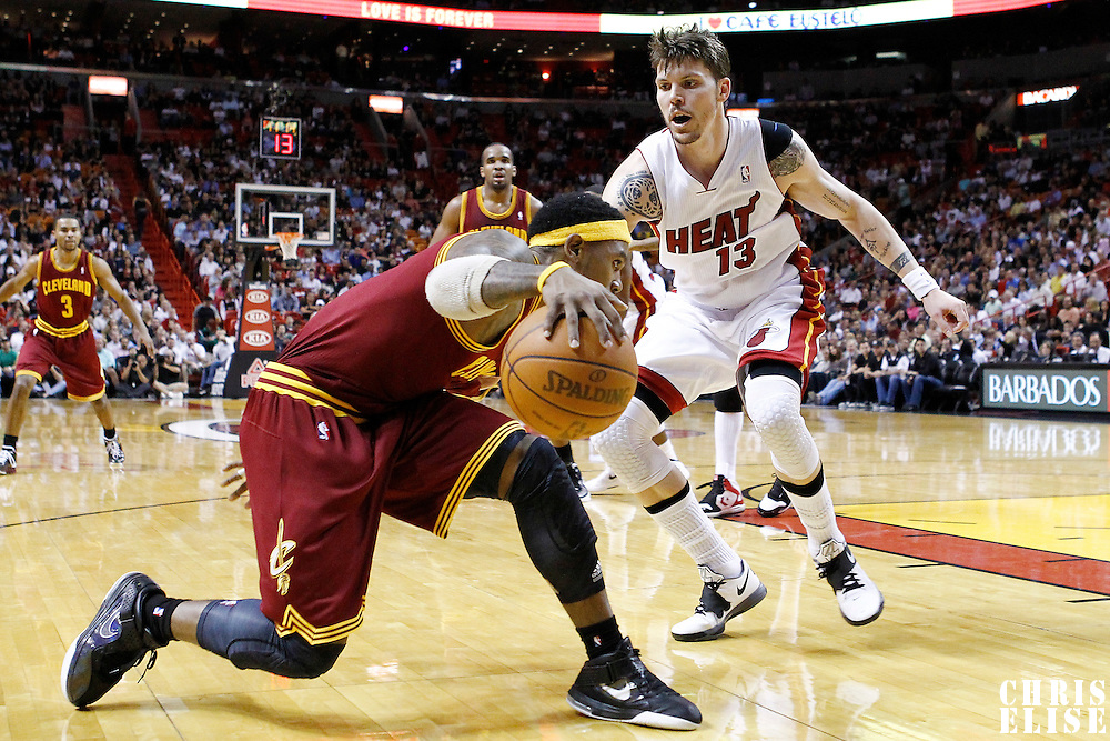 24 January 2012: Miami Heat shooting guard Mike Miller (13) defends on Cleveland Cavaliers shooting guard Daniel Gibson (1) during the Miami Heat 92-85 victory over the Cleveland Cavaliers at the AmericanAirlines Arena, Miami, Florida, USA.