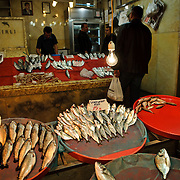 Customers buying fish at a fish shope next to the Spice Bazaar (also known as the Egyption Bazaar) in Istanbul, Turkey.
