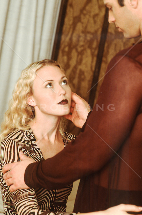 man touching the cheek of a woman