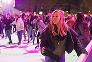 Manhattan, New York, U.S. 9th November 2013. Visitors ice skate and shop at the annual Holiday Shops, at Winter Village skating rink at Bryant Park that night.