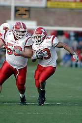 28 October 2006: Josh Tanner provides blocking for Marcus Mason. Youngstown State turned off over 15,000 fans as the win blew their way, cooling off Illinois State 27-13. Nationally ranked teams Youngstown State Penguins and Illinois State Redbirds competed at Hancock Stadium on the campus of Illinois State University in Normal Illinois.<br />