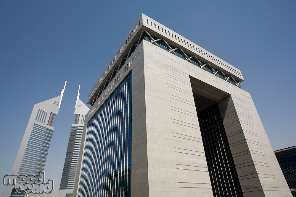 UAE Dubai The Gate building of the Dubai International Financial Centre and the Emirates Towers