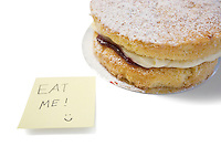 Cake slice with 'eat me' sign on sticky notepaper