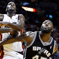 17 January 2012: San Antonio Spurs forward DeJuan Blair (45) vies for the rebound with Miami Heat center Joel Anthony (50) during the Miami Heat 120-98 victory over the San Antonio Spurs at the AmericanAirlines Arena, Miami, Florida, USA.