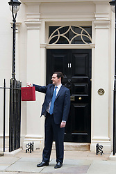 The Chancellor George Osborne poses on the steps of No11 Downing street with his red budget box for the 2014 Budget, London, United Kingdom. Wednesday, 19th March 2014. Picture by Nils Jorgensen / i-Images