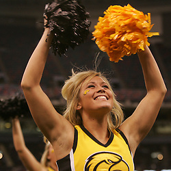 21 December 2008:  A Southern Miss cheerleader performs during a 30-27 overtime victory by the Southern Mississippi Golden Eagles over the Troy Trojans in the  R+L Carriers New Orleans Bowl at the New Orleans Superdome in New Orleans, LA.
