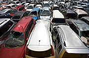 Thousands of cars wrecked by the March 11 quake and tsunami are lined up in a field near the airport in Natori, Miyagi Prefecture, Japan on 14 April, 2011. Authorities are unable to dispose of much of the debris created by the March disasters due to fears of radiation contamination, leading to giant mounds of waste that are becoming increasingly more toxic. Photographer: Robert Gilhooly