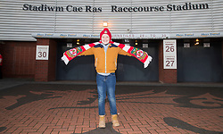 WREXHAM, WALES - Wednesday, March 20, 2019: A young Wales spectator holds a scarf ahead of the international friendly match between Wales and Trinidad and Tobago at the Racecourse Ground. (Pic by Laura Malkin/Propaganda)
