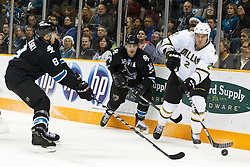 December 13, 2010; San Jose, CA, USA;  Dallas Stars defenseman Nicklas Grossman (2) passes the puck around San Jose Sharks center Joe Pavelski (8) and center Patrick Marleau (12) during the first period at HP Pavilion. Mandatory Credit: Jason O. Watson / US PRESSWIRE