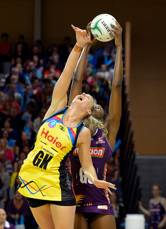 Pulses Katrina Grant attempts to defend against the Firebirds Romelda Aiken in the ANZ Netball Champions at te Ruaparaha Arena, Porirua, New Zealand, Monday, April 01, 2013. Credit:SNPA / Ross Setford