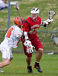 Maryland Terrapins Attack Will Yeatman (23) is defended by Virginia Cavaliers LSM Mike Timms (44).  The #9 ranked Maryland Terrapins fell to the #1 ranked Virginia Cavaliers 10 in 7 overtimes in Men's NCAA Lacrosse at Klockner Stadium on the Grounds of the University of Virginia in Charlottesville, VA on March 28, 2009.