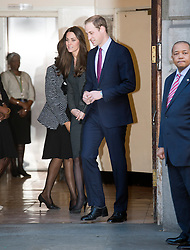 © London News Pictures. 11/12/2013.  Prince William and Catherine, Duchess of Cambridge, leaving South Africa House in central London after signing the Nelson Mandela book of condolence on December 11, 2013. Photo credit: Ben Cawthra/LNP