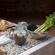 Fresh food ingredients for making bruschetta at a cooking class for tourists staying at the Villa Rosa agriturisimo, Panzano in Chianti, Italy<br />