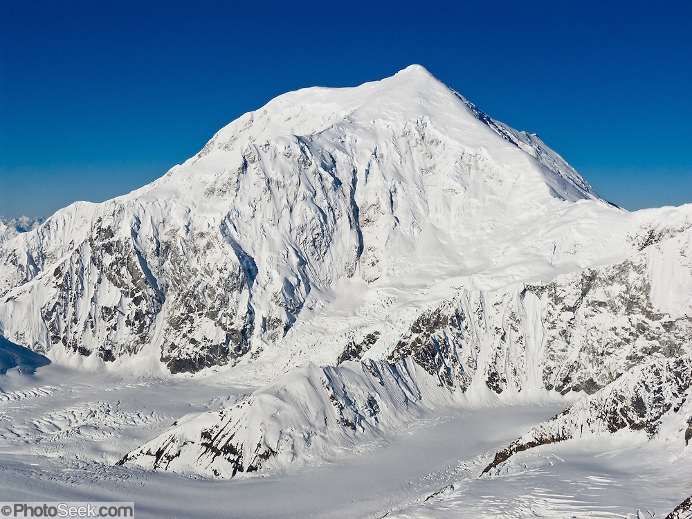 Flightsee over Mount Foraker (17,400 feet or 5304 m elevation) in Denali National Park and Preserve, Alaska, USA. See a vast wilderness of glaciers, icy peaks, and mile deep granite gorges in the Alaska Range.