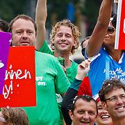 NLD/Amsterdam/20100807 - Boten tijdens de Canal Parade 2010 door de Amsterdamse grachten. De jaarlijkse boottocht sluit traditiegetrouw de Gay Pride af. Thema van de botenparade was dit jaar Celebrate, AVRO boot, Ewout Genemans