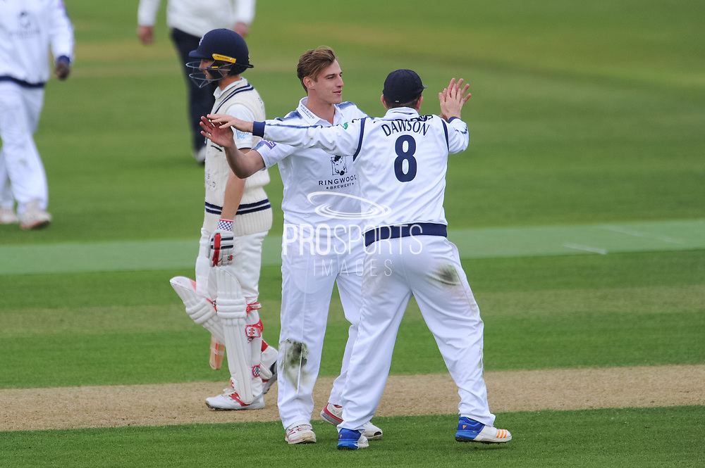Brad Wheal and Liam Dawson of Hampshire celkebrate the wicket of John Simpson of Middlesex during the Specsavers County Champ Div 1 match between Hampshire County Cricket Club and Middlesex County Cricket Club at the Ageas Bowl, Southampton, United Kingdom on 14 April 2017. Photo by David Vokes.