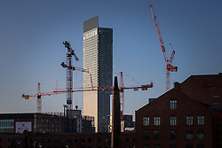 © Licensed to London News Pictures . 27/02/2014 . Manchester , UK . Manchester's iconic Beetham Tower surrounded by construction cranes and historic converted mills as the city's construction boom continues . Photo credit : Joel Goodman/LNP