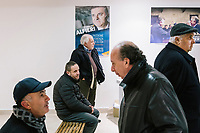 MONTECORICE, ITALY - 14 FEBRUARY 2018: Supporters of Franco Alfieri (Democratic Party, PD, Partito Democratico), a candidate running for the Chamber of Deptuies in the 2018 Italian General Elections, wait for the arrival of the candidate who will be rallying in the Council Chamber of Montecorice, Italy, on February 14th 2018.<br /> <br /> Montecorice is part of the electoral college of Agropoli, in the Campania region (southern Italy) in which Franco Alfieri (Democratic Party, PD, Partito Democratico), politically active for the past 30 years, is running agains the 28-years old Alessia d'Alessandro (Five Stars Movement, M5S, Movimento 5 Stelle).<br /> <br /> The 2018 Italian general election is due to be held on 4 March 2018 after the Italian Parliament was dissolved by President Sergio Mattarella on 28 December 2017.<br /> Voters will elect the 630 members of the Chamber of Deputies and the 315 elective members of the Senate of the Republic for the 18th legislature of the Republic of Italy, since 1948.Santa<br /> <br /> The 2018 Italian general election is due to be held on 4 March 2018 after the Italian Parliament was dissolved by President Sergio Mattarella on 28 December 2017.<br /> Voters will elect the 630 members of the Chamber of Deputies and the 315 elective members of the Senate of the Republic for the 18th legislature of the Republic of Italy, since 1948.