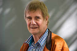 Pictured: Tom Young<br /> <br /> Tom Young (born 1962 in Raleigh, North Carolina) is an American novelist. He is known primarily as the author of the military thrillers The Mullah's Storm, Silent Enemy, The Renegades, The Warriors, and Sand and Fire. Young served in the Iraq and Afghanistan wars with the West Virginia Air National Guard. Young's military experience inspired his debut novel, The Mullah's Storm, which garnered positive reviews. The Mullah's Storm, Silent Enemy, and The Renegades received Gold Medal awards from the Military Writer's Society of America. Silent Enemy, The Renegades, and The Warriors received starred reviews from Publishers Weekly