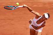 Paris, France - 2017 June 04: Magda Linette from Poland serves during her women's single match third round during tennis Grand Slam tournament The French Open 2017 (also called Roland Garros) at Stade Roland Garros on June 04, 2017 in Paris, France.<br /> <br /> Mandatory credit:<br /> Photo by &copy; Adam Nurkiewicz<br /> <br /> Adam Nurkiewicz declares that he has no rights to the image of people at the photographs of his authorship.<br /> <br /> Picture also available in RAW (NEF) or TIFF format on special request.<br /> <br /> Any editorial, commercial or promotional use requires written permission from the author of image.