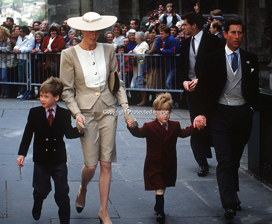 A May 1989 photo of Prince Charles and Princess Diana with their sons Princes William and Harry (C) at the wedding of Duke Hussey's daughter in Bath.<br /> Bath, GREAT BRITAIN - 05/1989