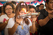 "29 SEPTEMBER 2012 - NAKORN NAYOK, THAILAND: Thai Buddhists seek the blessings of Ganesh during observances of Ganesh Ustav at Wat Utthayan Ganesh, a temple dedicated to Ganesh in Nakorn Nayok, about three hours from Bangkok. Many Thai Buddhists incorporate Hindu elements, including worship of Ganesh into their spiritual life. Ganesha Chaturthi also known as Vinayaka Chaturthi, is the Hindu festival celebrated on the day of the re-birth of Lord Ganesha, the son of Shiva and Parvati. The festival, also known as Ganeshotsav (""festival of Ganesha"") is observed in the Hindu calendar month of Bhaadrapada, starting on the the fourth day of the waxing moon. The festival lasts for 10 days, ending on the fourteenth day of the waxing moon. Outside India, it is celebrated widely in Nepal and by Hindus in the United States, Canada, Mauritius, Singapore, Thailand, Cambodia, Burma , Fiji and Trinidad & Tobago.      PHOTO BY JACK KURTZ"
