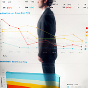 Businessman poses behind graphs - illustration of corporate transparency (model D.Mciver)