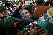 Protesters under the building of Constitutional Democratic Rally, RCD, party of Ben Ali, ask that the sign is removed...On 17 december Mohamed Bouazizi a fruit seller form the city of Sidibouzid in Tunisia set fire to himself starting a wave of protest that will change several arab countries under the name of Arab Spring..Despite the dictator Zine El-Abidine Ben Ali left the country on 14 January after weeks of protest the demonstrations continue asking for the political party of the regime (RCD) and all the political men involved on the past government where banned from the political life ..