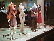 Some of us are fully dressed while others are left bare; Time-Warner Center, New York City.