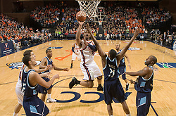 Virginia forward Jamil Tucker (12) shoots over Old Dominion forward Frank Hassell (21).  The Virginia Cavaliers men's basketball team defeated the Old Dominion Monarchs 80-76 in the second round of the College Basketball Invitational (CBI) at the University of Virginia's John Paul Jones Arena in Charlottesville, VA on March 24, 2008.