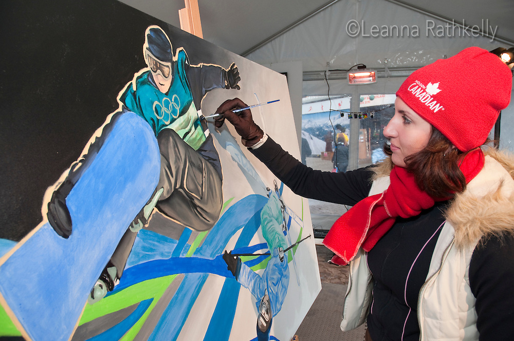 Artist Amanda Shatzko paints during Whistler Live, a cultural program part of the 2010 Olympic Winter Games in Whistler, BC