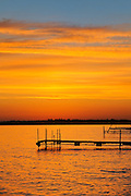 Docks on Clearwater Lake at sunrise<br /> Clearwater Lake Provincial Park<br /> Manitoba<br /> Canada