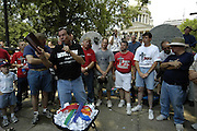 Flip Benham, leader of , Operation Save America waives his bible as he protests outside the state capital in Jackson Mississippi Tuesday July 18,2006. Benham ripped up copies of Supreme court rulings includinng Roe-vs-Wade, a copy of the Koran and a rainbow flag and planned on burning them all, except the jackson police would not allow a fire to be set on the steps citing a burn ban in the capital. Operation Save America is anti-abortion and plans to protest in jackson for as long as it takes to close the clinic, they are also planning protest at the state capital.(Photo©Suzi Altman)