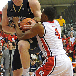 Notre Dame Fighting Irish guard Scott Martin (14) avoids being stripped by Rutgers Scarlet Knights guard Myles Mack (4) during Big East NCAA action during Rutgers' 65-58 victory over Notre Dame at the Louis Brown Athletic Center in Piscataway, N.J.