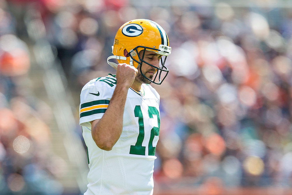 CHICAGO, IL - SEPTEMBER 13:  Aaron Rodgers #12 of the Green Bay Packers pumps his fist after getting a good call during a game against the Chicago Bears at Soldier Field on September 13, 2015 in Chicago, Illinois.  The Packers defeated the Bears 31-23.  (Photo by Wesley Hitt/Getty Images) *** Local Caption *** Aaron Rodgers