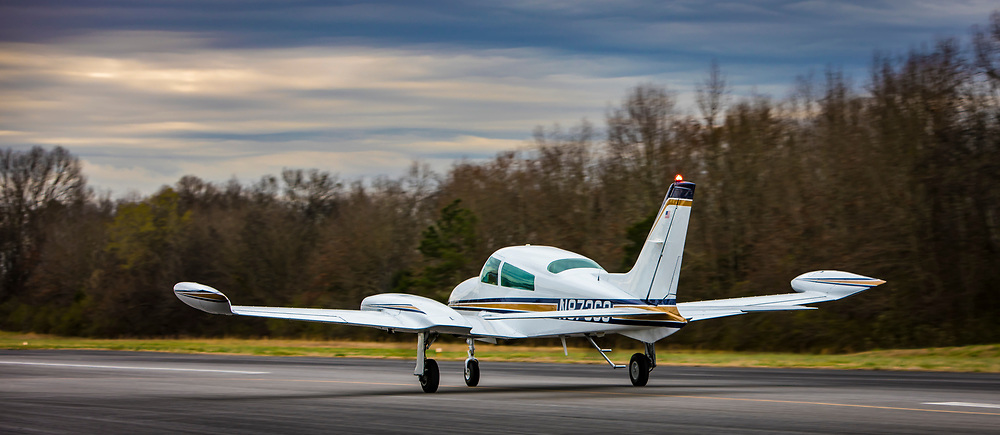 A 1975 CESSNA 310R aircraft  just after landing at the Tom B. David airport in Calhoun, Georgia.  Created by aviation photographer John Slemp of Aerographs Aviation Photography. Clients include Goodyear Aviation Tires, Phillips 66 Aviation Fuels, Smithsonian Air & Space magazine, and The Lindbergh Foundation.  Specialising in high end commercial aviation photography and the supply of aviation stock photography for commercial and marketing use.