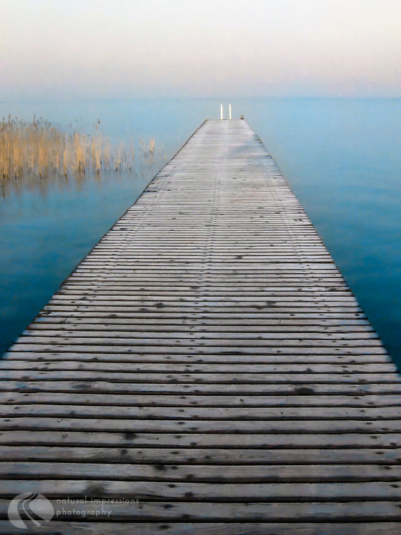 A long walk to an undisturbed on an isolated pier in Lake Garda.